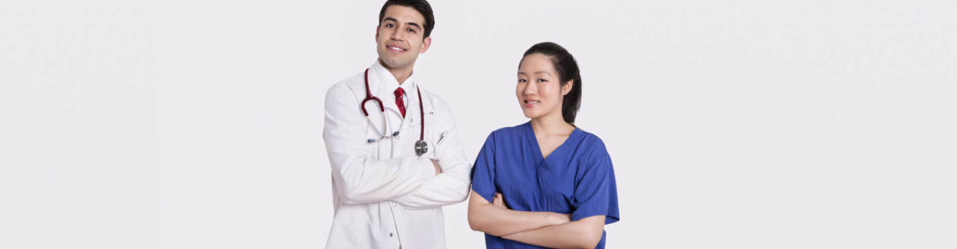 male doctor and female nurse smiling